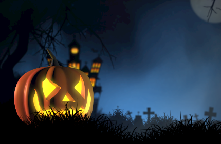 jackolanterns with haunted house and cemetery