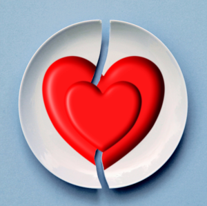broken plate with a broken heart image covered with a whole heart image