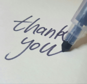 thank you written with calligraphy pen