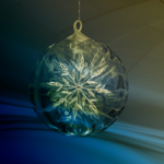 picture of glass ornament with snowflake on blue background