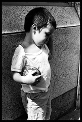 Black and white photo of a child alone