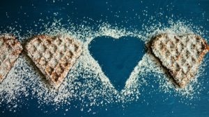 Waffles in the shape of hearts with sugar sprinkled on top